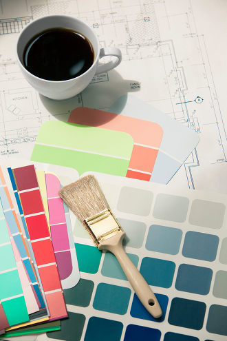 Picture of swatches and a paintbrush on blueprints. Note to inspector: blueprints are my own.