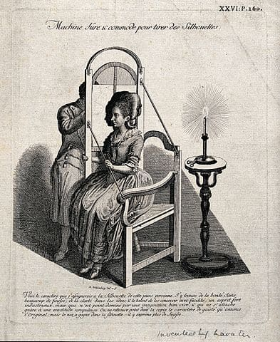 393px-a_man_drawing_the_silhouette_of_a_seated_woman_on_translucen_wellcome_v0049670