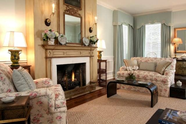 fireplace living space with patterned seating