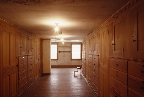 Attic in Shaker dwelling-house filled with drawers.