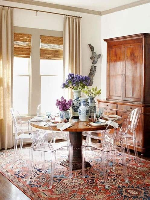 lucite-chairs-in-traditional-dining-room