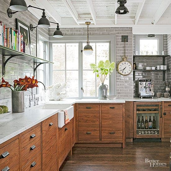 Wooden lower cabinets with a gray tiled backsplash and sleek open shelves.