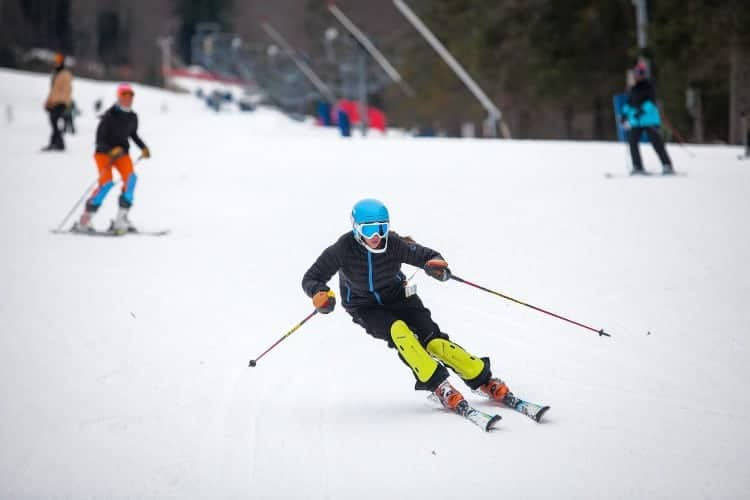 The Ski Team at Pat's Peak in Henniker (town next door) starts at age 7. Amateur adult league is every evening under the lights. Photo Concord Monitor.