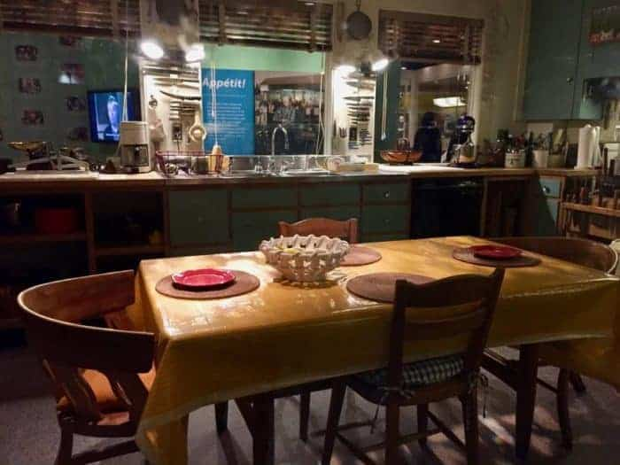 Julia Child's kitchen with an imitate, family center table.
