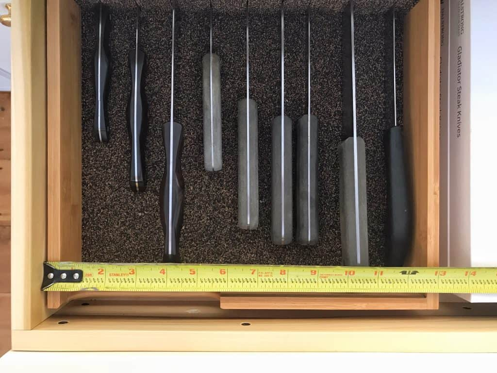 Below it, I store all my knives. So all I have to do is whisk one out and start chopping!